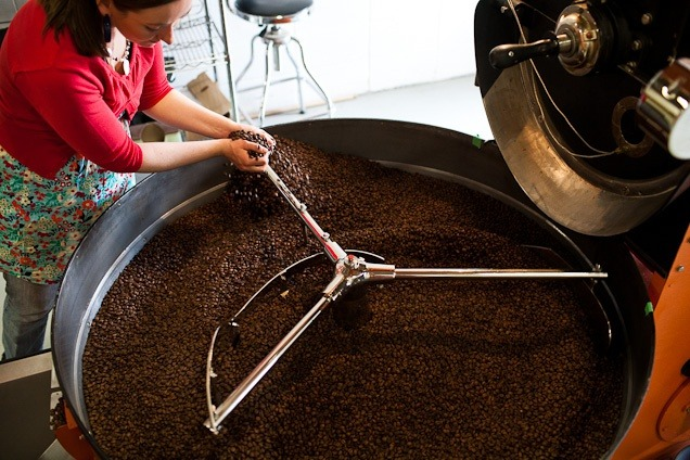 Lady roasting coffee beans