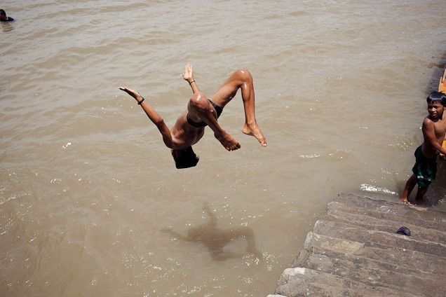Boy backflips into river